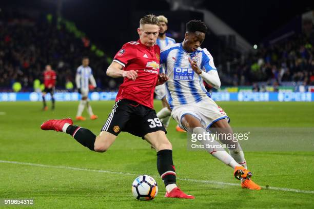 Scott McTominay of Manchester United is challenged by Terence Kongolo of Huddersfield Town during the Emirates FA Cup Fifth Round match between...