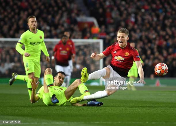 Scott McTominay of Manchester United is fouled by Sergio Busquets of Barcelona during the UEFA Champions League Quarter Final first leg match between...