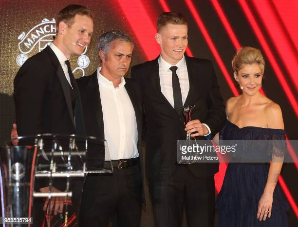 Scott McTominay of Manchester United is presented with his Manager's Player of the Season award by Manager Jose Mourinho at Manchester United's...