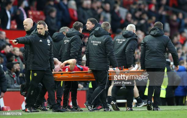 Scott McTominay of Manchester United is stretchered off during the Premier League match between Manchester United and Brighton Hove Albion at Old...
