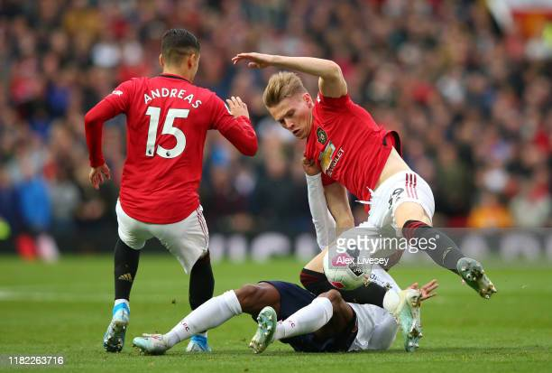 Scott McTominay of Manchester United is tackled by Georginio Wijnaldum of Liverpool during the Premier League match between Manchester United and...