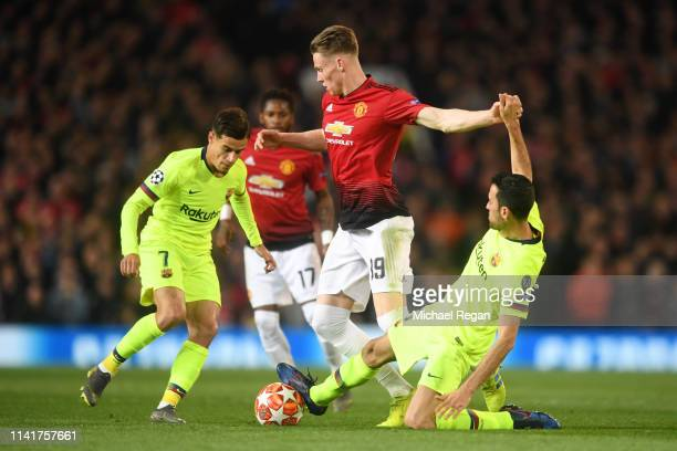 Scott McTominay of Manchester United is tackled by Sergio Busquets of Barcelona during the UEFA Champions League Quarter Final first leg match...
