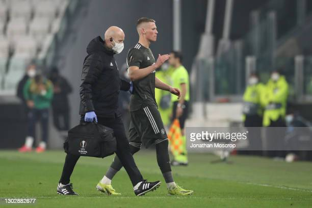 Scott McTominay of Manchester United leaves the field of play to be substituted after picking up an injury during the UEFA Europa League Round of 32...
