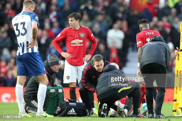 Scott McTominay of Manchester United lies injured during the Premier League match between Manchester United and Brighton Hove Albion at Old Trafford...