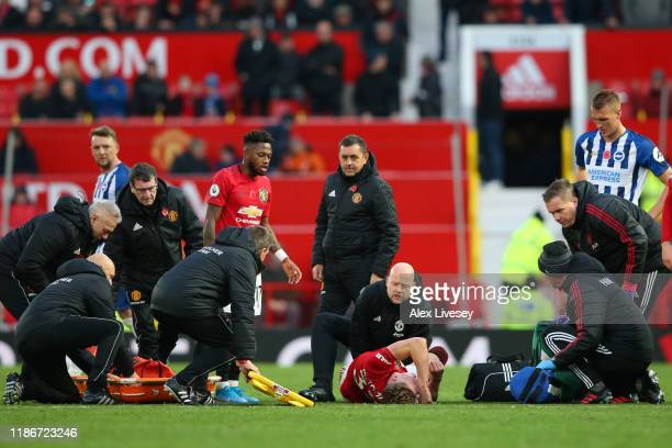 Scott McTominay of Manchester United receives medical treatment during the Premier League match between Manchester United and Brighton Hove Albion at...