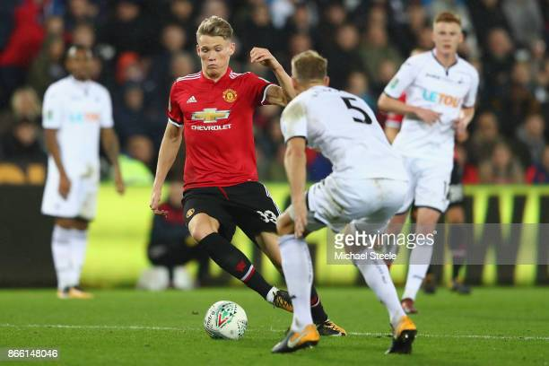 Scott McTominay of Manchester United runs at Mike van der Hoorn of Swansea City during the Carabao Cup fourth round match between Swansea City and...