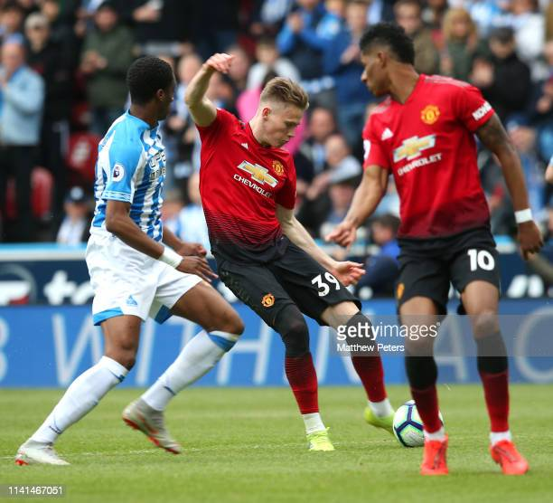 Scott McTominay of Manchester United scores the first goal during the Premier League match between Huddersfield Town and Manchester United at John...