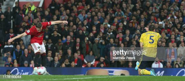 Scott McTominay of Manchester United scores their first goal during the Premier League match between Manchester United and Arsenal FC at Old Trafford...