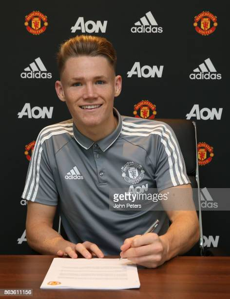 Scott McTominay of Manchester United signs a new contract with the club at Aon Training Complex on October 20 2017 in Manchester England