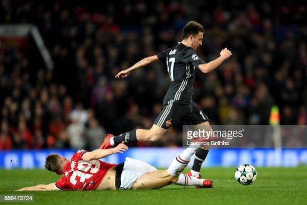 Scott McTominay of Manchester United tackles Aleksandr Golovin of CSKA Moscow during the UEFA Champions League group A match between Manchester...
