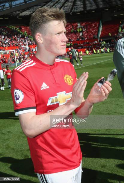 Scott McTominay of Manchester United takes part in a lap of honour after the Premier League match between Manchester United and Watford at Old...