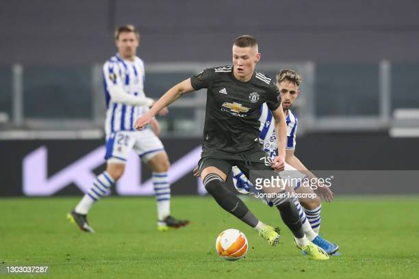 Scott McTominay of Manchester United turns with the ball as he is pursued closely by Adnan Januzaj of Real Sociedad during the UEFA Europa League...