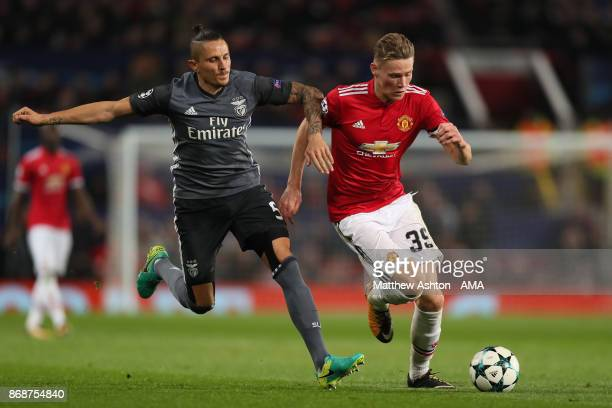 Scott McTominay of Manchester United tussles for posession with Ljubomir Fejsa of Benfica during the UEFA Champions League group A match between...
