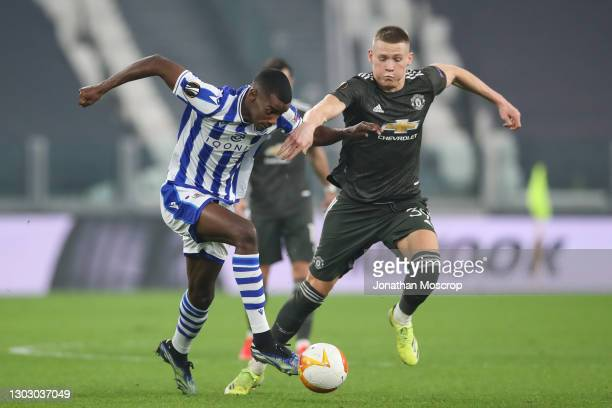 Scott McTominay of Manchester United tussles with Alexander Isak of Real Sociedad as he breaks with the ball during the UEFA Europa League Round of...
