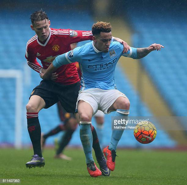 Scott McTominay of Manchester United U21s in action with Kean Bryan of Manchester City U21s during the Barclays U21 Premier League match between...