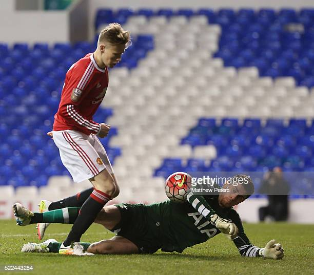 Scott McTominay of Manchester United U21s in action with Luke McGee of Tottenham Hotspur U21s during the Barclays U21 Premier League match between...