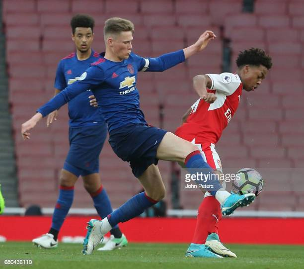 Scott McTominay of Manchester United U23s in action with Christoper WIllock of Arsenal U23s during the Premier League 2 match between Arsenal U23s...