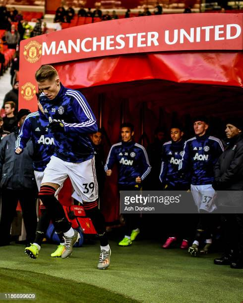 Scott McTominay of Manchester United warms up ahead of the Premier League match between Manchester United and Brighton Hove Albion at Old Trafford on...