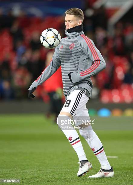 Scott McTominay of Manchester United warms up ahead of the UEFA Champions League Round of 16 Second Leg match between Manchester United and Sevilla...
