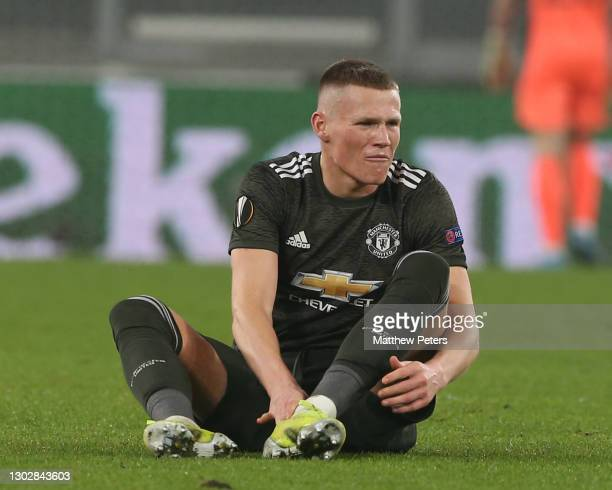 Scott McTominay of Manchester United winces in pain during the UEFA Europa League Round of 32 match between Real Sociedad and Manchester United at...