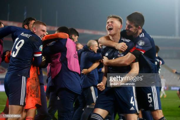 Scott McTominay of Scotland and Declan Gallagher of Scotland celebrate after the UEFA EURO 2020 Play-Off Final between Serbia and Scotland at Rajko...