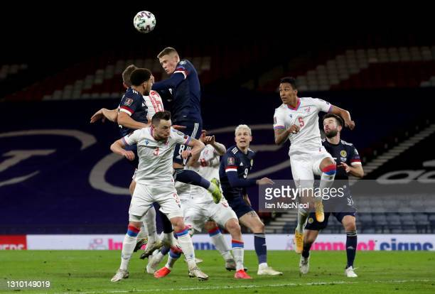 Scott McTominay of Scotland and Gunnar Vatnhamar jump for a header during the FIFA World Cup 2022 Qatar qualifying match between Scotland and Faroe...