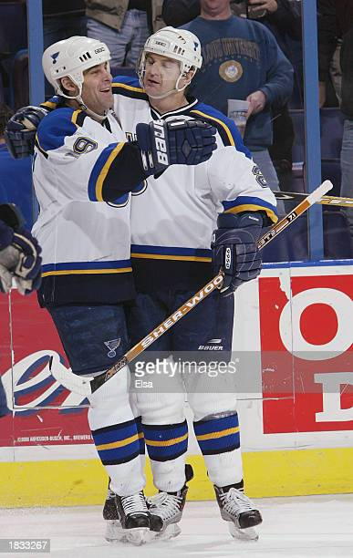 Scott Mellanby of the St Louis Blues celebrates his hat trick with teammate Al MacInnis in the third period against the Phoenix Coyotes on March 6...