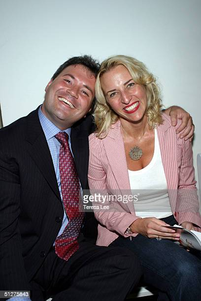 Scott Mendelson and Wendy Ballew pose in the front row at the Alvin Valley Show during Olympus Fashion Week Spring 2005 at Bryant Park September 8...