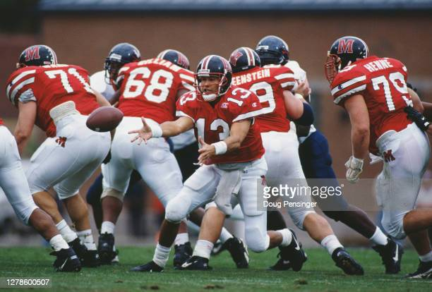 Scott Milanovich, Quarterback for the University of Maryland Terrapins hands the football off during the NCAA Atlantic Coast Conference college...