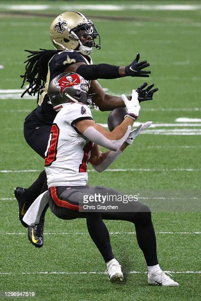 Scott Miller of the Tampa Bay Buccaneers catches a pass against Janoris Jenkins of the New Orleans Saints during the fourth quarter in the NFC...