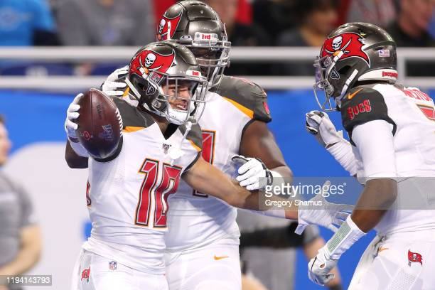 Scott Miller of the Tampa Bay Buccaneers celebrates his first half touchdown with Jameis Winston while playing the Detroit Lions at Ford Field on...