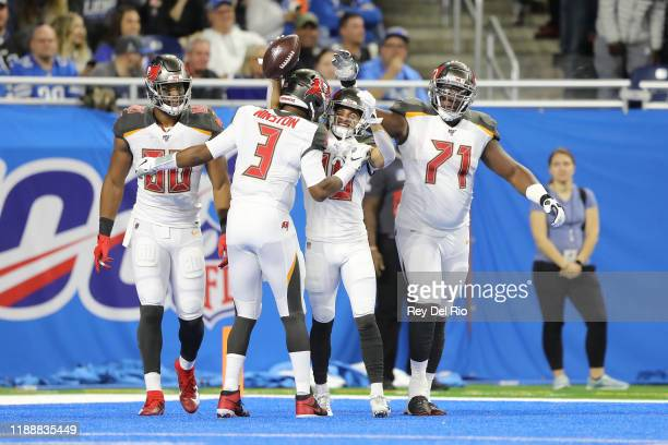Scott Miller of the Tampa Bay Buccaneers celebrates his first quarter touchdown with Jameis Winston of the Tampa Bay Buccaneers against the Detroit...
