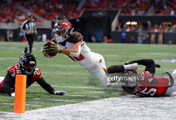 Scott Miller of the Tampa Bay Buccaneers is tackled by Deion Jones of the Atlanta Falcons short of the pylon at MercedesBenz Stadium on November 24...