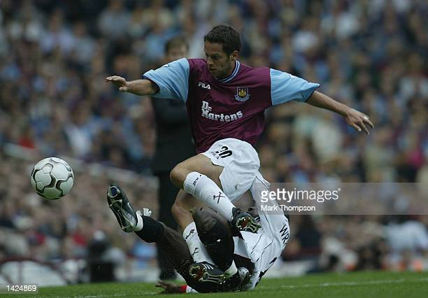 Scott Minto of West Ham is tackled by Shaun WrightPhillips of Manchester City during the FA Barclaycard Premiership match between West Ham United and...