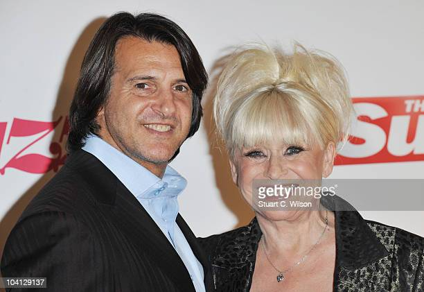Scott Mitchell and Barbara Windsor attend The Sun's new magazine 'Buzz' launch at Il Bottacio on September 15 2010 in London England