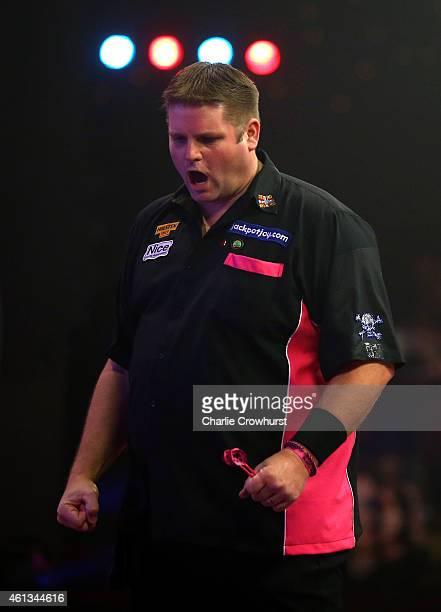 Scott Mitchell of England celebrates winning a set during the mens final against Martin Adams of England during the BDO Lakeside World Professional...