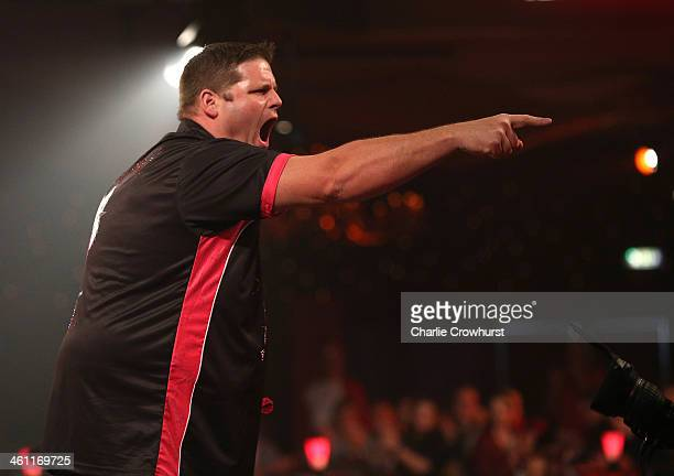Scott Mitchell of England celebrates winning his first round match against Paul Hogan of England during one of the BDO Lakeside World Professional...