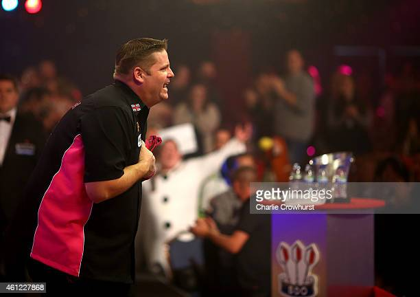 Scott Mitchell of England celebrates winning his quarter final match against Brian Dawson of England during the BDO Lakeside World Professional Darts...