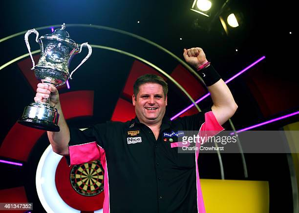 Scott Mitchell of England celebrates with the trophy after winning the mens final against Martin Adams of England during the BDO Lakeside World...