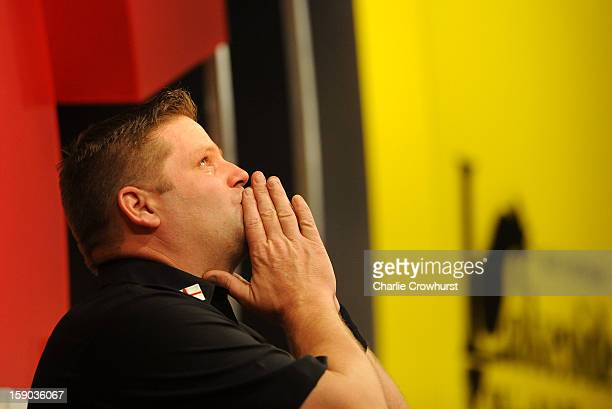 Scott Mitchell of England gets emotional after he wins his first round match against Mark Barilli on day two of the BDO Lakeside World Professional...