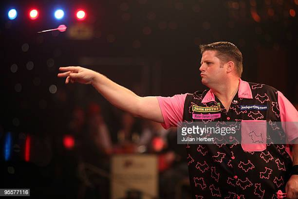 Scott Mitchell of England in action against Daryl Gurney of Northern Ireland during the First Round Match of World Professional Darts Championship at...