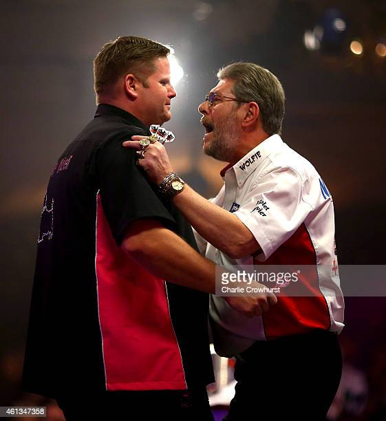 Scott Mitchell of England is congratulated by Martin Adams of England as he celebrates winning the mens final against Martin Adams of England during...