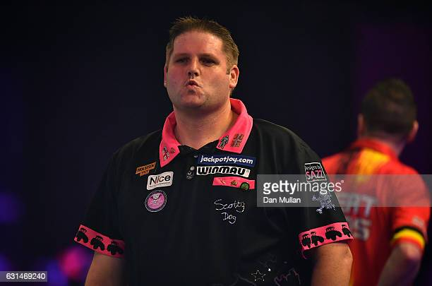 Scott Mitchell of England reacts during his Mens second round match against Geert de Vos of Belgium on Day Five of the BDO Lakeside World...