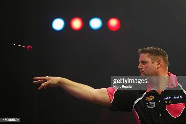 Scott Mitchell of England throws during his first round match against Tony O'Shea of England on day one of the BDO Lakeside World Professional Darts...