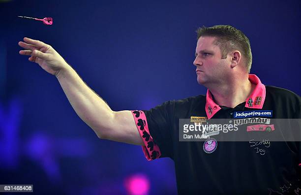 Scott Mitchell of England throws during his Mens second round match against Geert de Vos of Belgium on Day Five of the BDO Lakeside World...