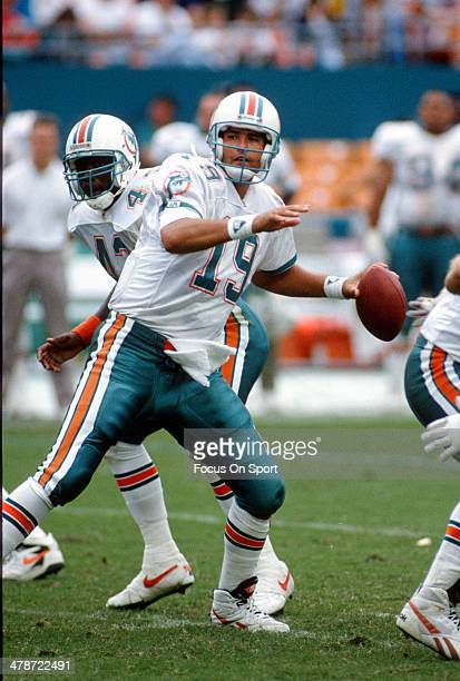 Scott Mitchell of the Miami Dolphins drops back to pass against the Kansas City Chiefs during an NFL football game October 31 1993 at Joe Robbie...
