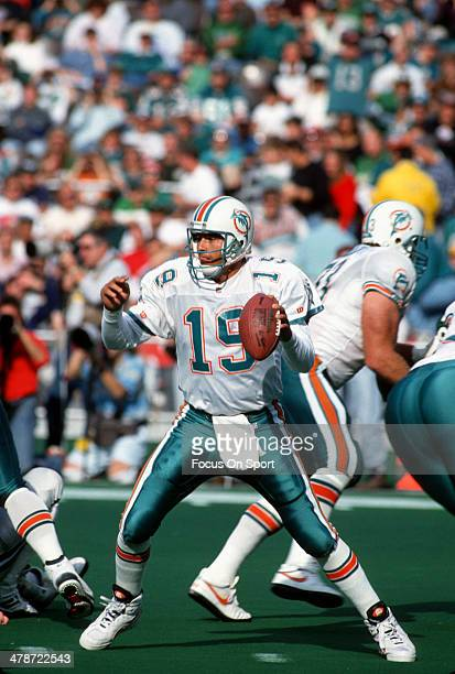 Scott Mitchell of the Miami Dolphins drops back to pass against the Philadelphia Eagles during an NFL football game November 14 1993 at Veterans...