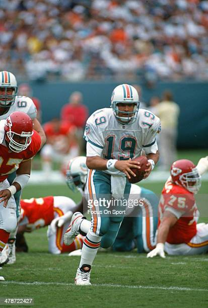Scott Mitchell of the Miami Dolphins scrambles with the ball against the Kansas City Chiefs during an NFL football game October 31 1993 at Joe Robbie...