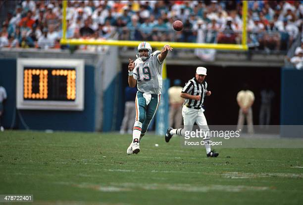 Scott Mitchell of the Miami Dolphins throws a pass against the Kansas City Chiefs during an NFL football game October 31 1993 at Joe Robbie Stadium...