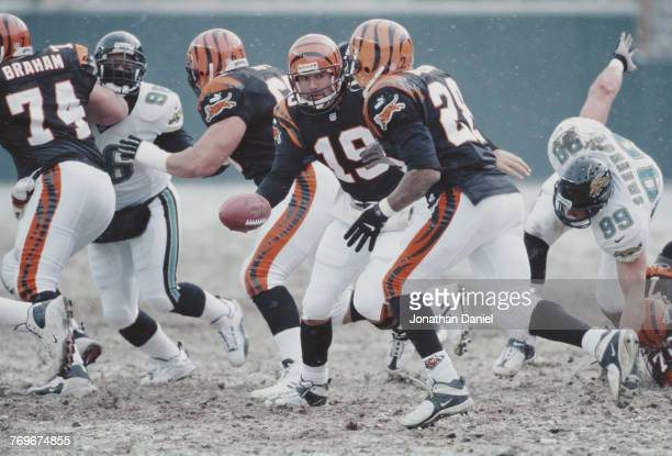 Scott Mitchell Quarterback for the Cincinnati Bengals hands off the ball to Running back Corey Dillon during the American Football Conference Central...